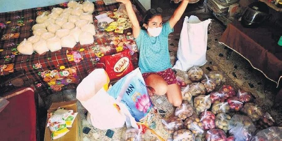 Prerna Kumari with the raw material collected and bought by her group. (Photo   Express)