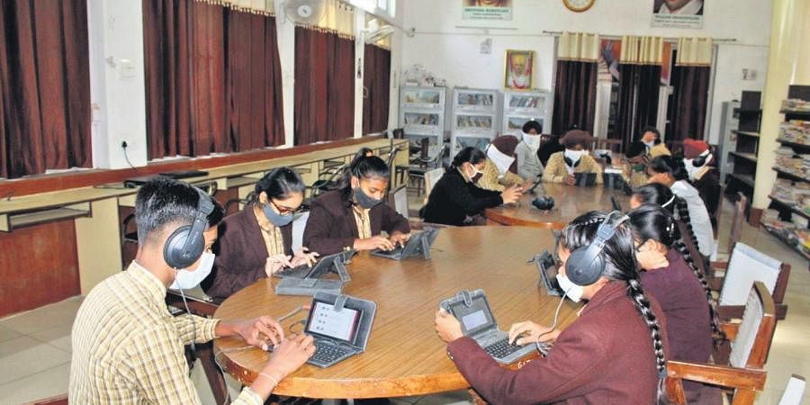 12,976 smart schools have been set up across the state and students are now taught through e-content (digital teaching) through projectors. (Photo   Express)
