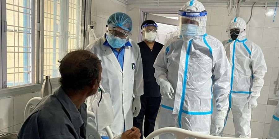 Uttarakhand Chief Minister Tirath Singh Rawat in PPE kit meets Covid patients at a district hospital in Uttarkashi