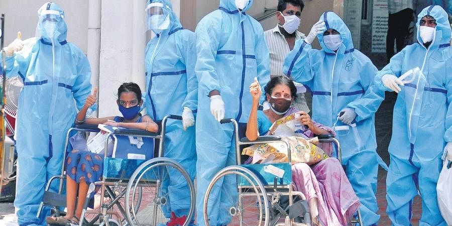 Covid patients wave after their discharge from Vizag's KGH.