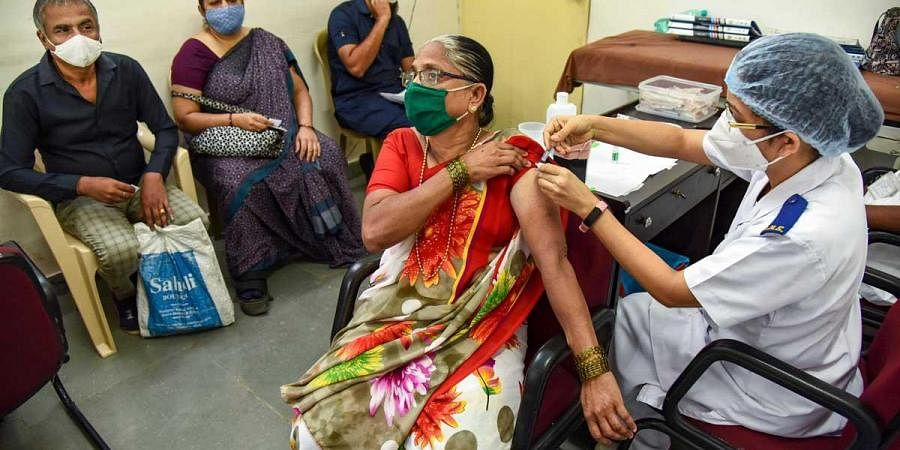 A health worker administers a dose of the COVID-19 vaccine at NMMC hospital, in Mumbai. (Photo | PTI)