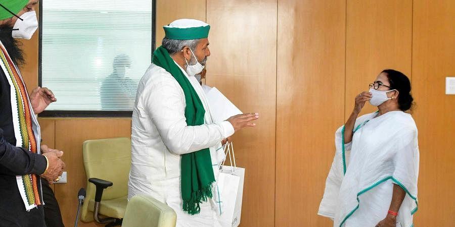 BKU Spokesperson Rakesh Singh Tikait meets West Bengal CM Mamata Banerjee at State Secretariat, Nabanna, in Kolkata, Wednesday, June 9, 2021.