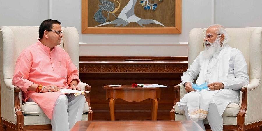 Uttarakhand CM Pushkar Singh Dhami meets Prime Minister Narendra Modi in New Delhi, Saturday, July 10, 2021.