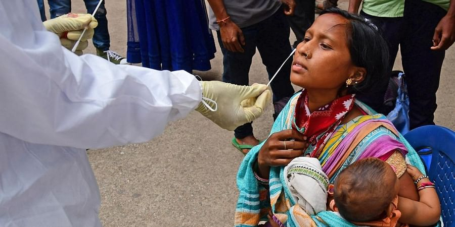 A health worker collects swab samples of a woman in Bengaluru. (Photo   Shriram BN, EPS)