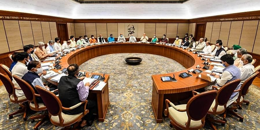 Prime Minister Narendra Modi chairs a meeting with new Union Cabinet Ministers, at his official residence in New Delhi, July 14, 2021.