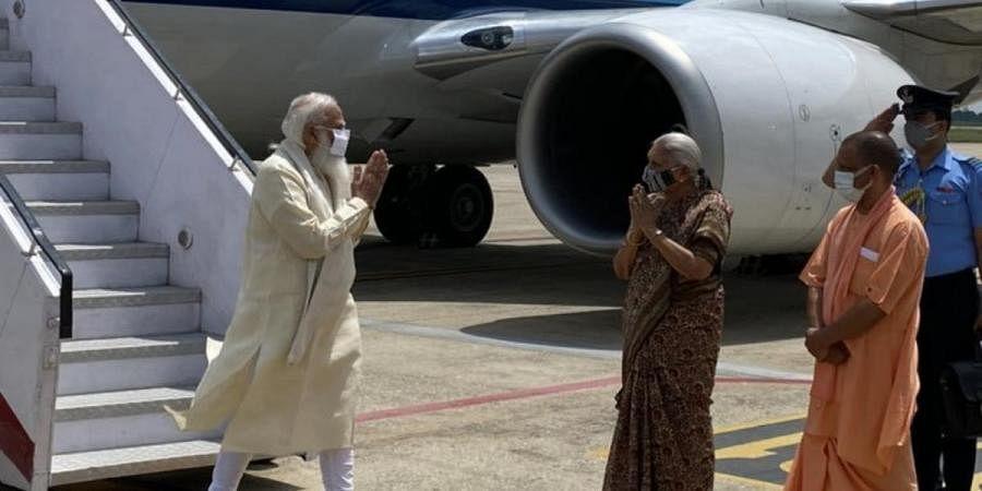 PM Narendra Modi greets uttar Pradesh governor Anandiben Patel after landing at Varanasi