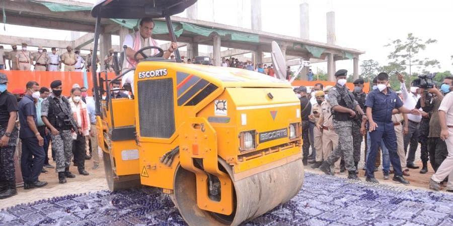 Assam CM Himanta Biswa Sarma drives a road roller over seized cough syrups