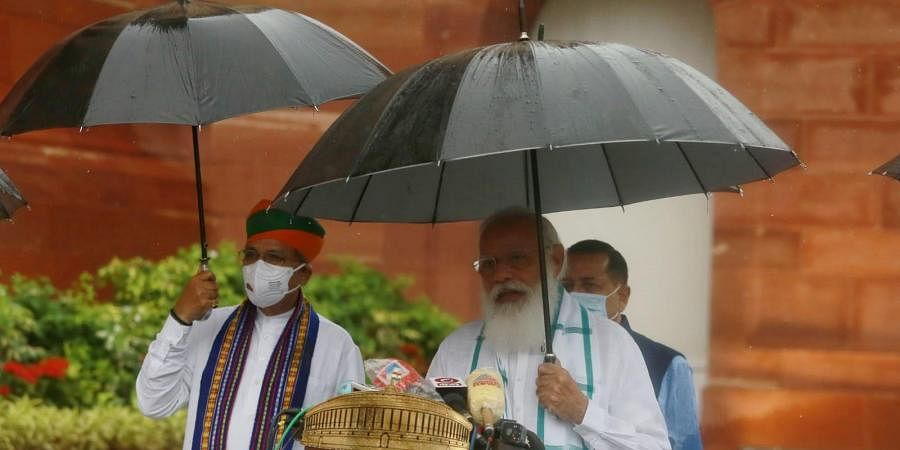 Prime Minister Narendra Modi addresses the media, as it rains on the first day of the Monsoon Session of Parliament, in New Delhi (Photo | Shekhar Yadav, EPS)