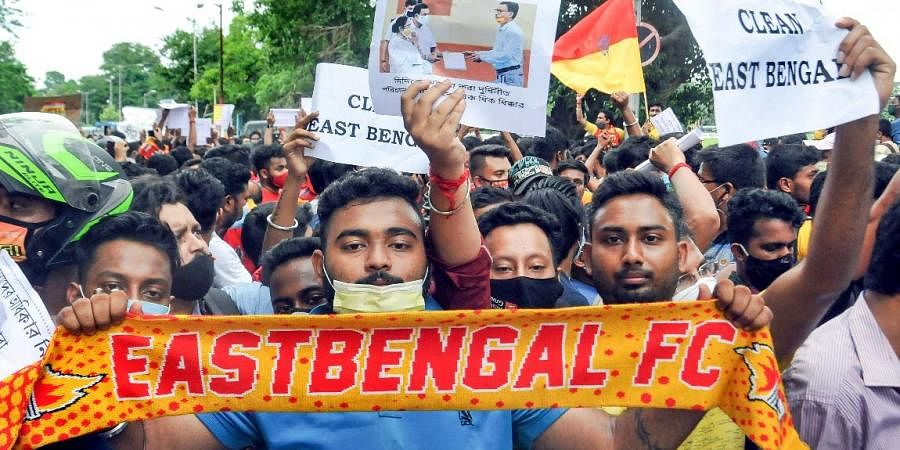 Fans during their protest against managing authorities of the East Bengal Club, near club premises in Kolkata