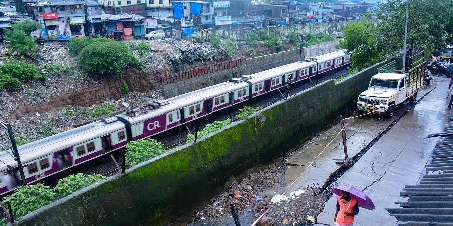Heavy overnight rains in Mumbai and neighbouring areas led to flooding and washing out of some rail tracks