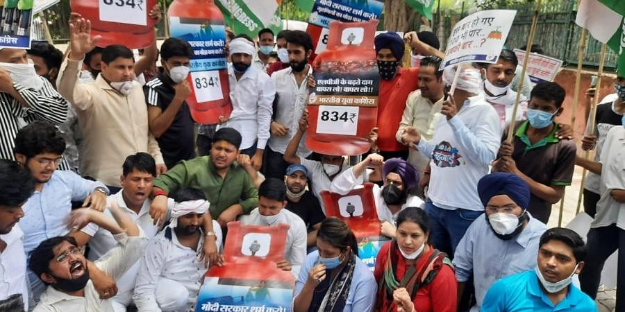 Delhi Youth Congress activists Protesting against the LPG and Petrol price hike in New Delhi on Saturday.