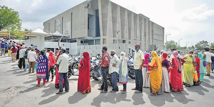 A long wait and queue to take the shot at a vaccination centre operating out of a community hall in Ahmedabad on Friday