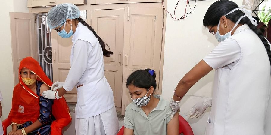 Health workers administer a dose of COVID-19 vaccine to beneficiaries during a special one-day vaccination drive, in Beawar, Saturday, July 3, 2021. (Photo   PTI)