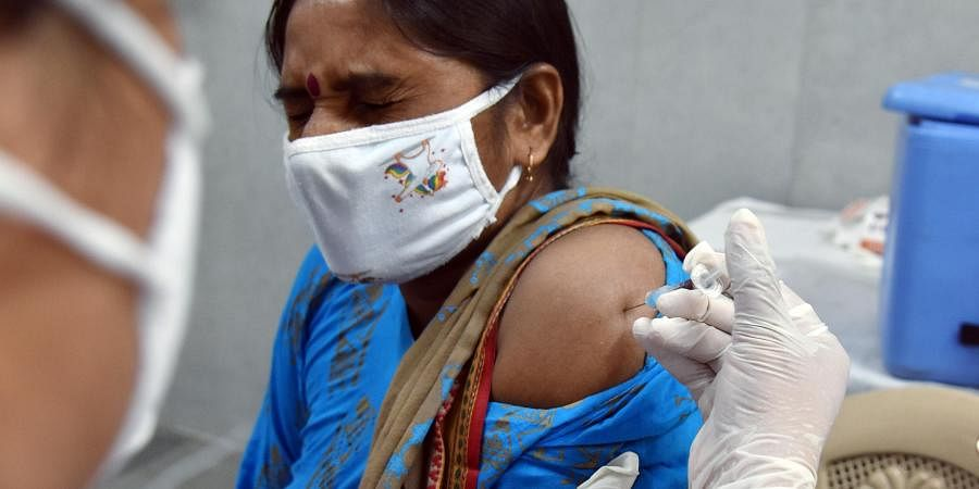 A healthcare worker inoculates a dose of the COVID-19 vaccine to a beneficiary, in New Delhi on Saturday. (Photo | ANI)