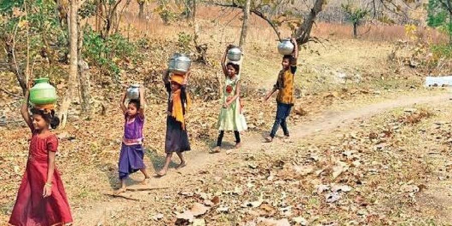 Children belonging to Kolam tribe travel long distances to fetch drinking water