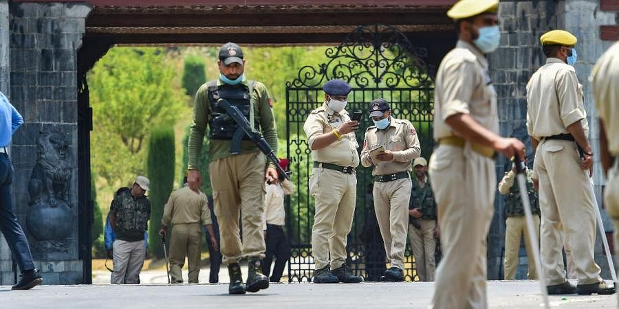 Security personnel stand guard as members of Delimitation Commission arrive to meet leaders of different political parties, in Srinagar