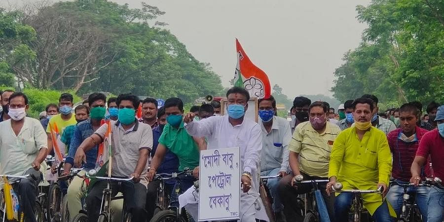 West Bengal minister Becharam Manna cycles to protest rise in petrol price