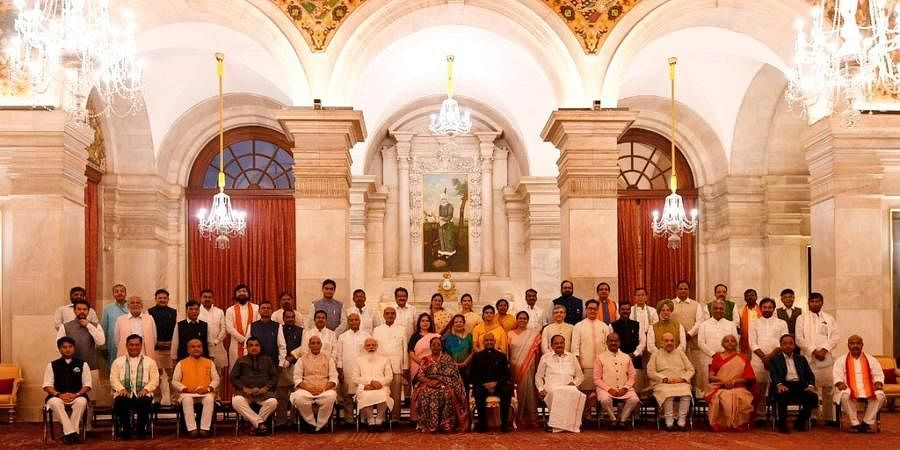 President Ram Nath Kovind, First Lady Savita, Vice President M Venkaiah Naidu, PM Narendra Modi and LS Speaker Om Birla in a group photograph with the newly sworn-in Council of Ministers.