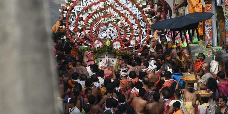 Lord Jagannath was ushered out of the temple in Pahandi Bije, Puri on Tuesday morning marking the beginning of the prestigious Rath Yatra. (Photo|Biswanath Swain, EPS)