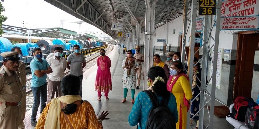 Railway cops, some in civilian clothes, and representatives of child organisations, who were involved in rescuing children seen at a railway station in Bengaluru Division.