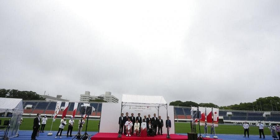 Olympic flame arrives in Tokyo amid resignations, anger ...