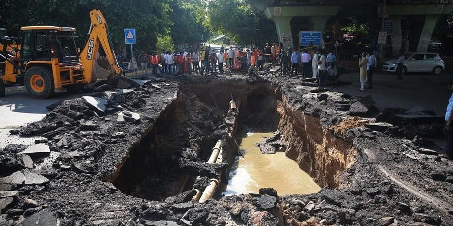 A portion of a road that caved in near IIT flyover, in New Delh