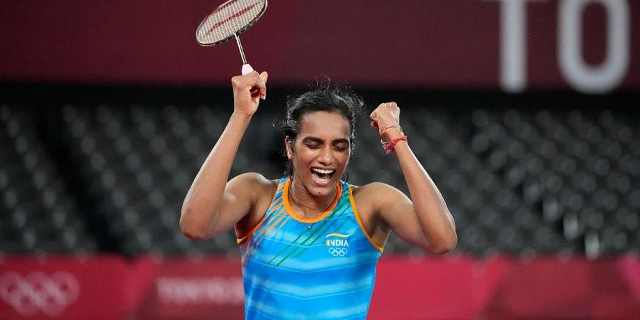 PV Sindhu celebrates a point against He Bing Jiao of China during thewomen's singles badminton bronze medal match at the 2020 Olympics