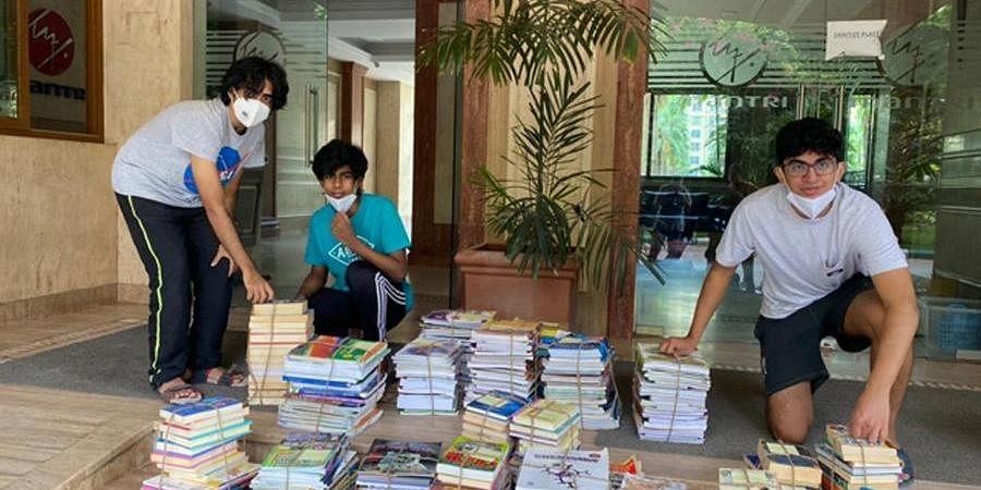 (From left) Praneet  Gudladana, Harish Shankar, and Aryan Gupta with the donated  books.