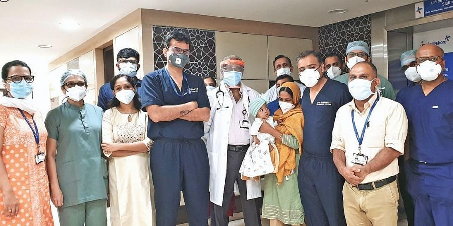 Baby Fathima Filza and family with Dr Abhishek Yadav and members of the comprehensive liver care team at VPS Lakeshore Hospital, Kochi.