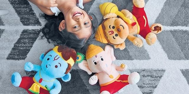 Baby versions of Hindu gods Ganesha, Krishna and Hanuman with squeezy bellies, these toys when pressed, belt out shlokas.