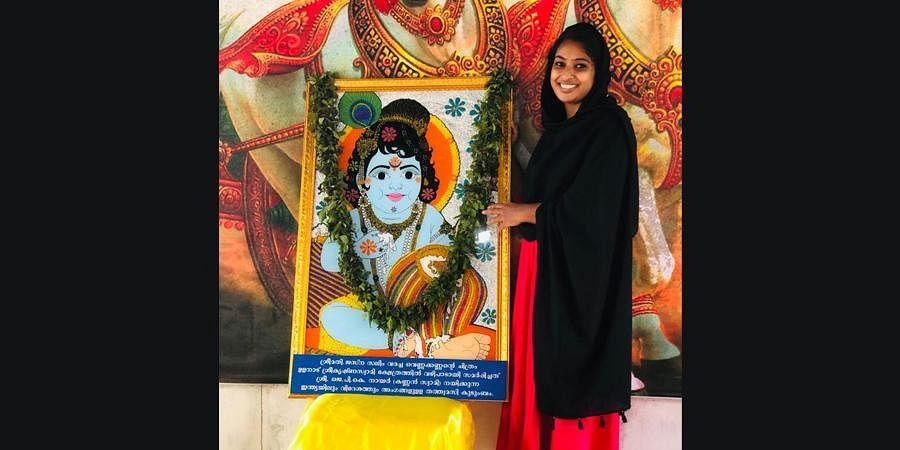 Jasna Salim with her painting of .Little Krishna at Ulanadu Sree Krishna Swamy temple in Pandalam.